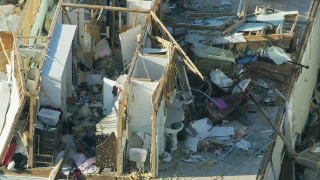 aerial view hurricane devastation property roofs ripped away - vortex stock videos & royalty-free footage
