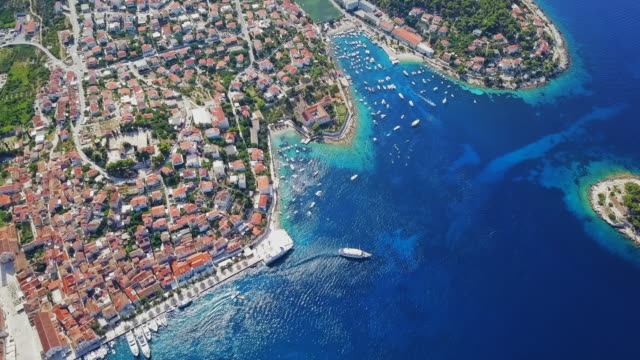 aerial view hvar coastline & city - freibad stock-videos und b-roll-filmmaterial