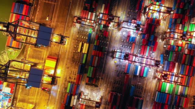 vídeos de stock e filmes b-roll de 4k aerial view hyper lapse of hong kong kwai tsing container terminal at night - pier