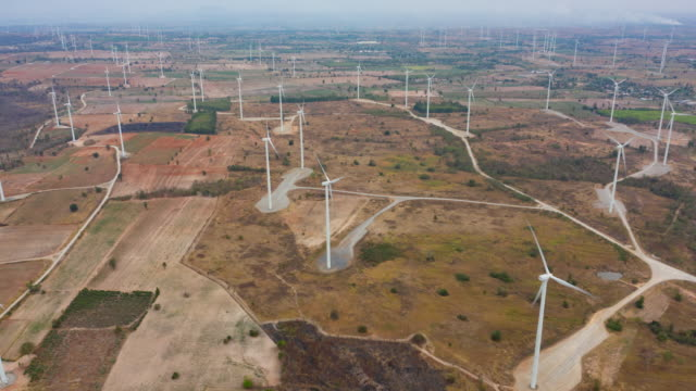 aerial view hyper lapse wind turbine farm is working - power in nature stock videos & royalty-free footage