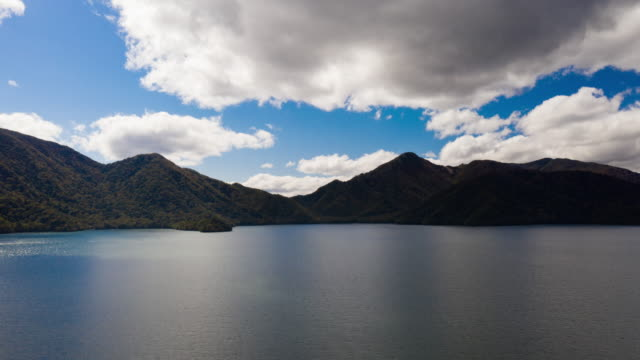 aerial view hyper lapse zoom out lake mountain and blue sky in asia - light natural phenomenon stock videos & royalty-free footage