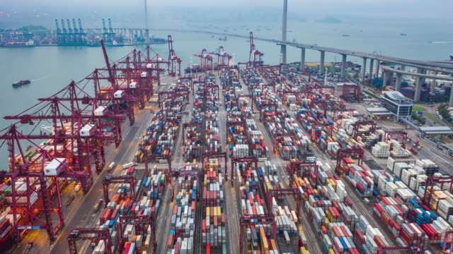aerial view hyperlapse 4k video of container cargo ship in export and import business and logistics international goods. - haulage stock videos & royalty-free footage