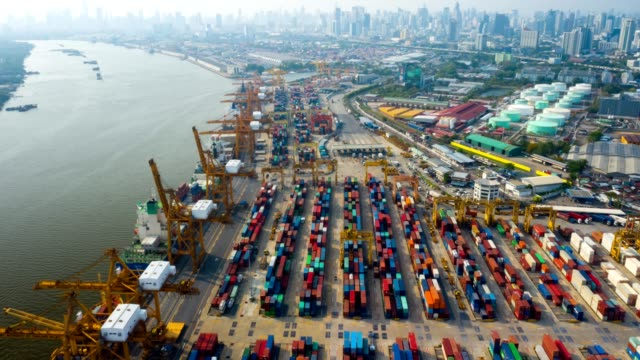 Aerial view hyper-lapse or time-lapse of Industrial port with containers ship