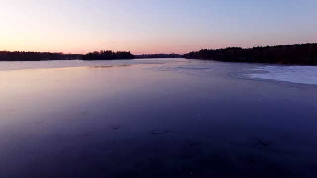 aerial view: ice on dark lake - frozen stock videos and b-roll footage