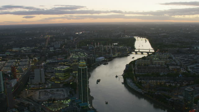 aerial view illuminated buildings london cityscape at sunset - battersea stock videos & royalty-free footage