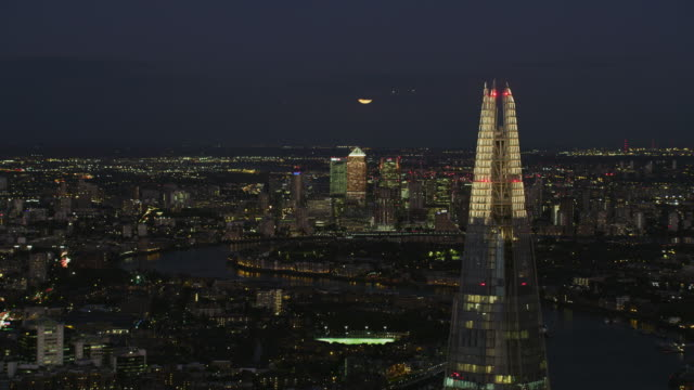 aerial view illuminated city skyline at night london - skyline stock videos & royalty-free footage