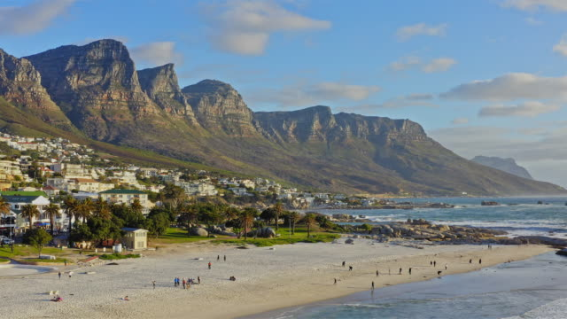 aerial view in camps bay, cape town, south africa - coastline stock videos & royalty-free footage