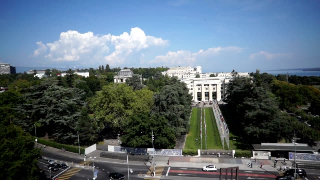 aerial view in front of united nations office in geneva, switzerland - united nations building stock videos and b-roll footage