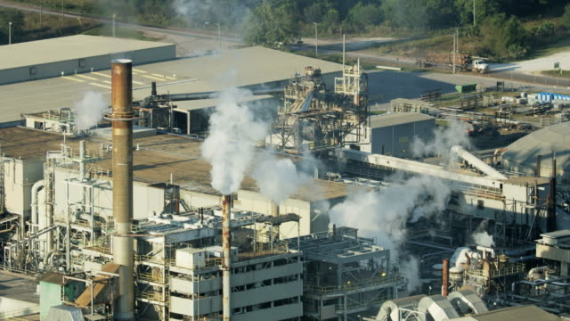 aerial view industrial paper mill manufacturing paper usa - paper mill stock videos and b-roll footage