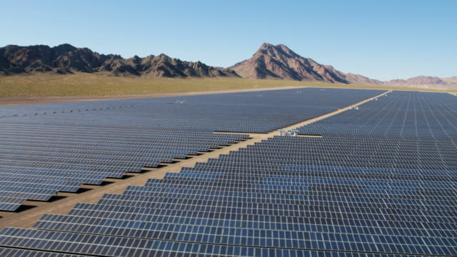 aerial view industrial photovoltaic solar power station nevada - nevada stock-videos und b-roll-filmmaterial