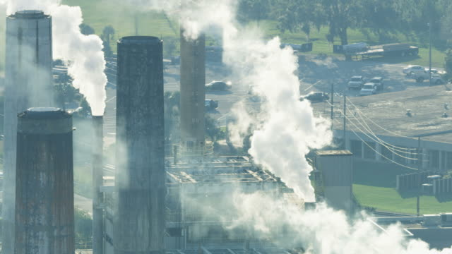 aerial view industrial plant towers extracting smoke emissions - air pollution stock videos & royalty-free footage