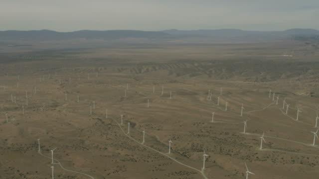 Aerial view industrial wind energy turbines California desert