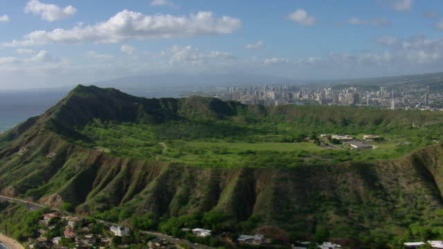 Aerial view inside Diamond Head Crater and distant skyscrapers in Honolulu, Hawaii.