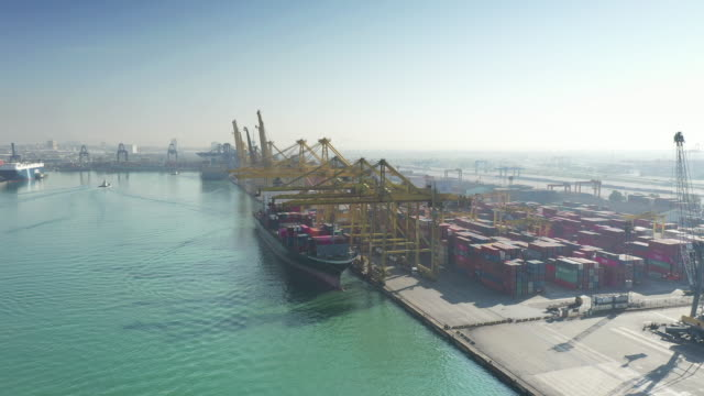 aerial view international port with crane loading containers in import export business logistics - long beach california stock videos & royalty-free footage