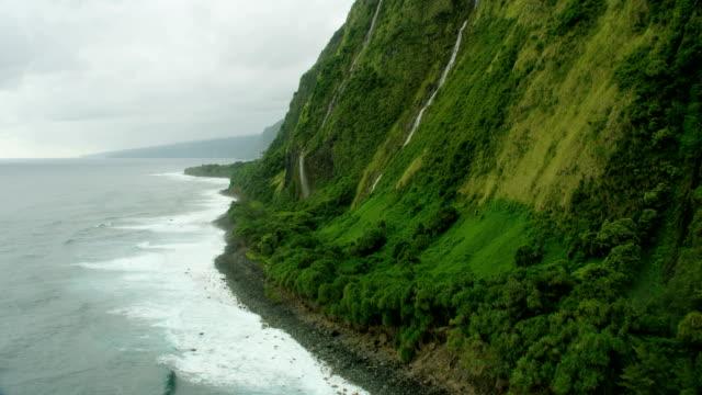 aerial view jurassic cliffs pacific ocean coastline waterfall - jurassic stock videos & royalty-free footage