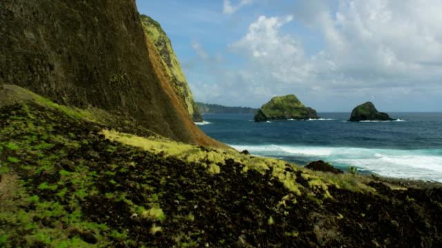 aerial view jurassic fertile coastline rainforests waterfalls hawaii - jurassic stock videos & royalty-free footage