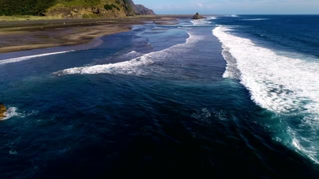 aerial view, karekare beach new zealand - coastline stock videos & royalty-free footage