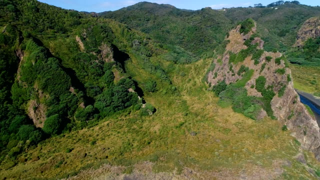 aerial view, karekare beach new zealand - hill stock videos & royalty-free footage