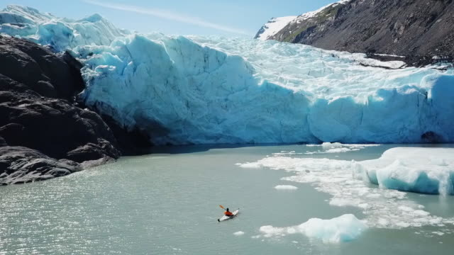 aerial view kayaker in bay observing glacier - glacier stock videos & royalty-free footage