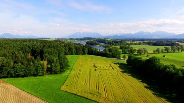 stockvideo's en b-roll-footage met luchtfoto: lake abtsee, beieren in de zomer - heuvellandschap