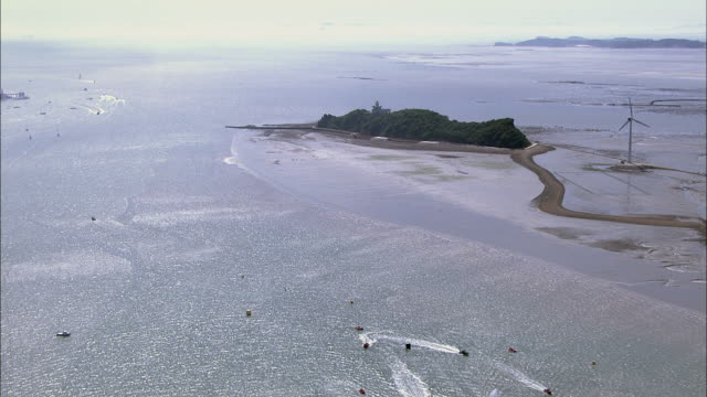 Aerial view Landscape of Nue island on mud flat and wind turbine