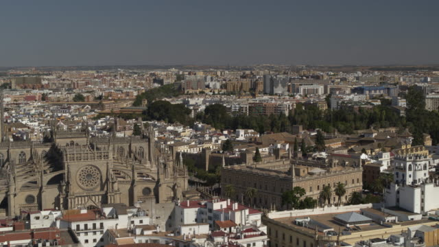 aerial view leaving tower of catedral de sevilla in cityscape / seville, seville, spain - andalucia stock videos & royalty-free footage