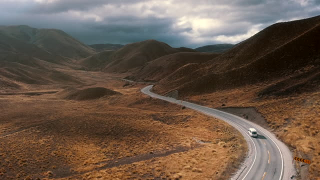aerial view lindis pass country road - country road stock videos & royalty-free footage