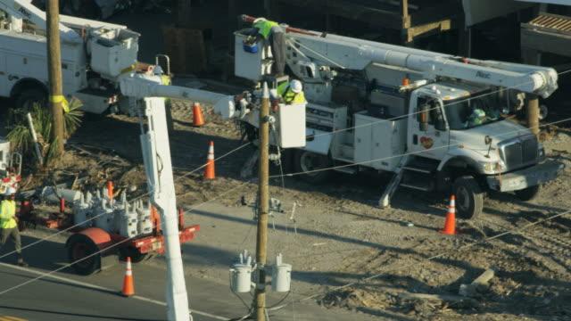 aerial view linesman vehicles repairing broken electricity wires - 2018 stock videos & royalty-free footage