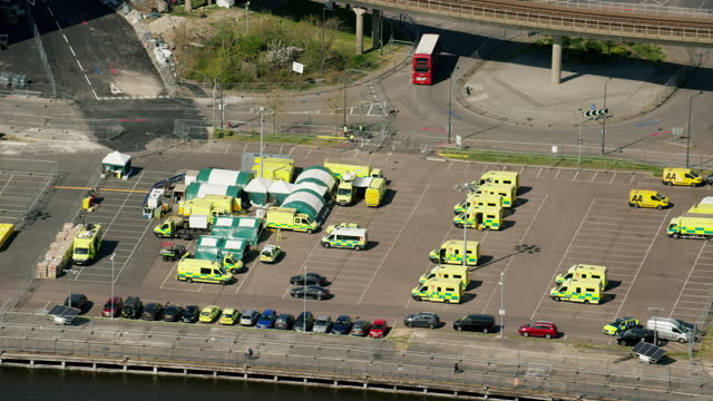 aerial view london ambulance vehicles covid19 nightingale hospital - nhs stock videos & royalty-free footage