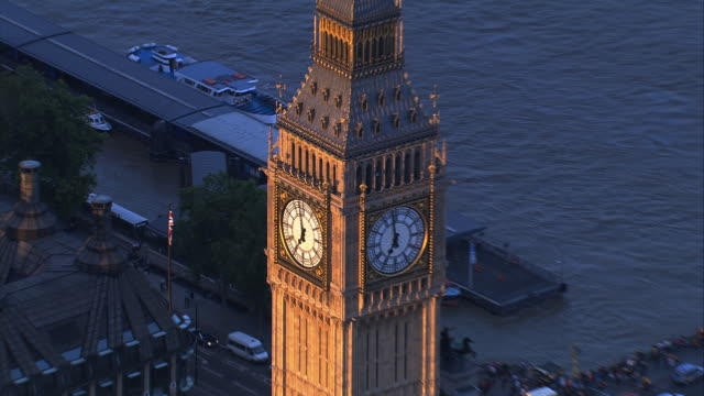 aerial view london: big ben bell tower and clock face. - london england stock videos and b-roll footage
