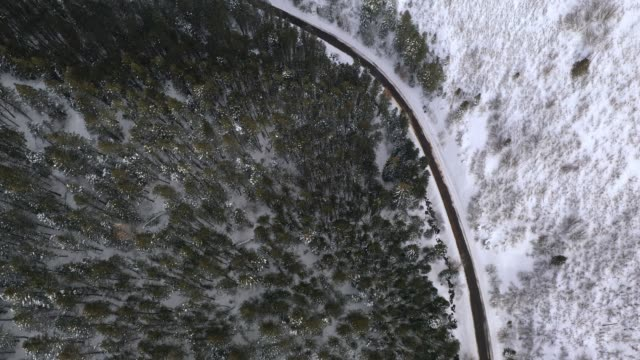 aerial view looking down at road curving through canyon in winter - american fork city stock videos & royalty-free footage