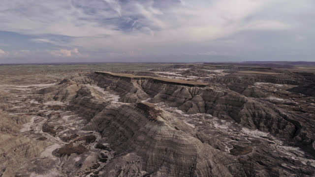 DRONE. Aerial view looking down at serene landscape of Badlands formations and canyons