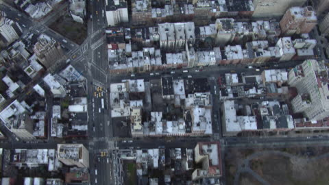 aerial view looking down at washington square park and the streets and rooftops of greenwich village. - greenwich village stock videos & royalty-free footage