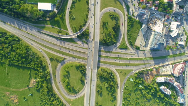 aerial view looking down eagle eye shot of highway road in sofia, bulgaria in time lapse - wide stock videos & royalty-free footage