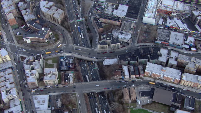 Aerial View Looking Down On Busy Roads And Rooftops Of The