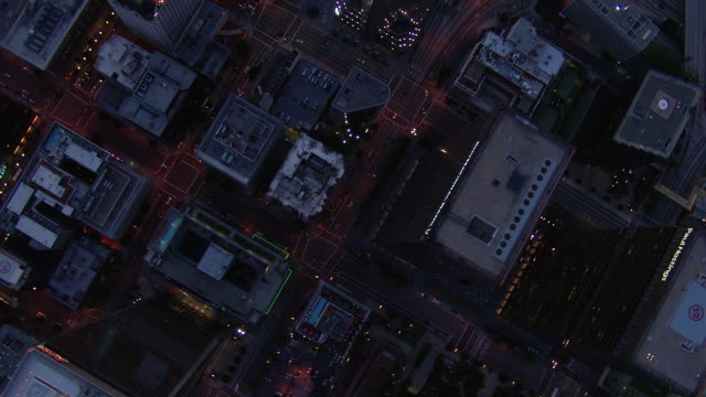 aerial view looking straight down at skyscrapers and streets of downtown los angeles. - straight stock videos and b-roll footage