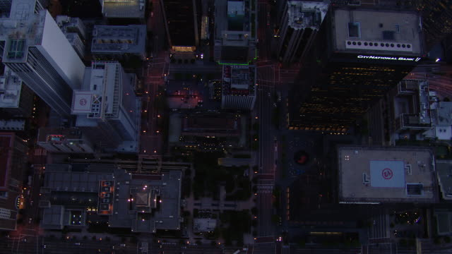 aerial view looking straight down at skyscrapers in downtown los angeles. - straight stock videos and b-roll footage