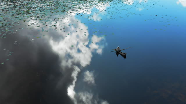 aerial view man in boat on lake azuei with sky & clouds reflecting in the water - cumulus bildbanksvideor och videomaterial från bakom kulisserna