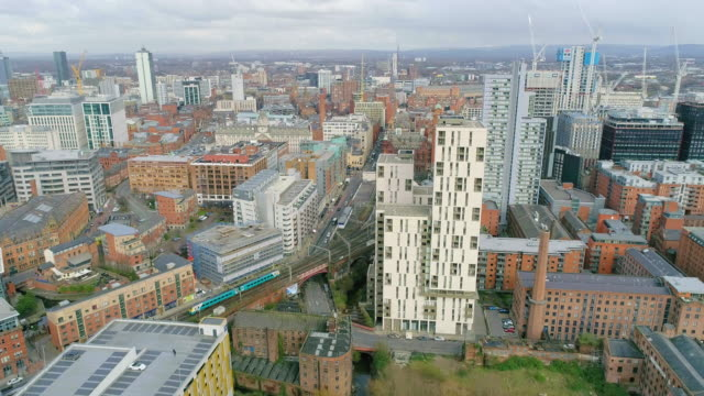 aerial view manchester train passing urban sprawl towards oxford road station - flat stock videos & royalty-free footage