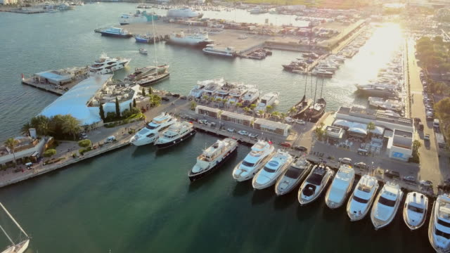 aerial view marina with boats docked - jachthafen stock-videos und b-roll-filmmaterial