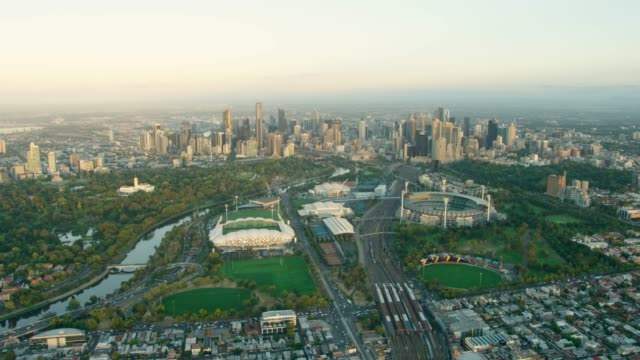 aerial view melbourne city skyline at sunrise australia - stadium stock videos & royalty-free footage