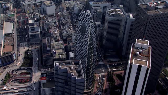 aerial view metropolitan skyscrapers downtown buildings financial tokyo - beton stock-videos und b-roll-filmmaterial