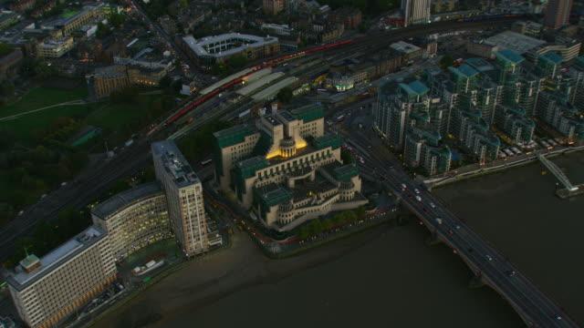 aerial view mi6 building at sunset london england - mi6 stock-videos und b-roll-filmmaterial