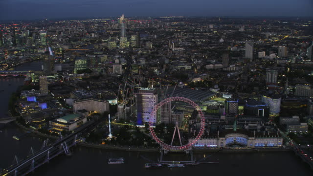 aerial view millennium wheel at night london england - skyline stock videos & royalty-free footage