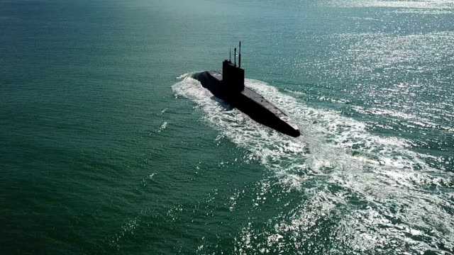aerial view - missile submarine at sea - russia stock videos & royalty-free footage