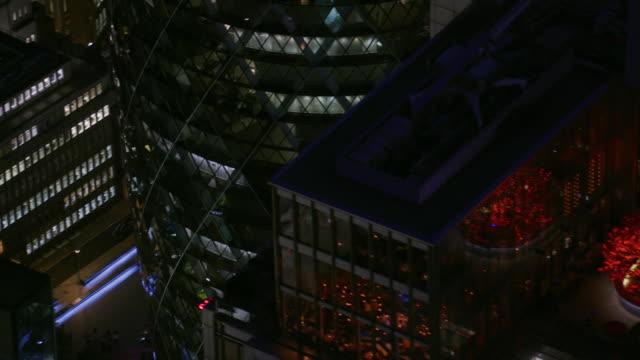 vidéos et rushes de aerial view modern glass skyscrapers at night london - dusk