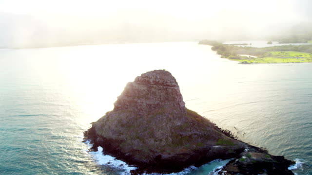 aerial view mokolii chinaman's hat kualoa point hawaii - polynesian ethnicity stock videos and b-roll footage