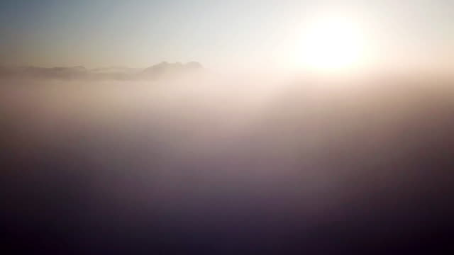 aerial view mountain and sunrise above the clouds - air vehicle stock videos & royalty-free footage