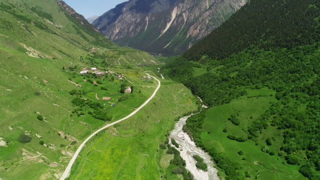 aerial view. mountains and river. - mountain range stock videos & royalty-free footage