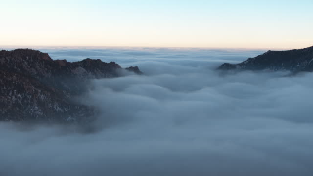 aerial view moving away from fog - boulder rock stock videos & royalty-free footage